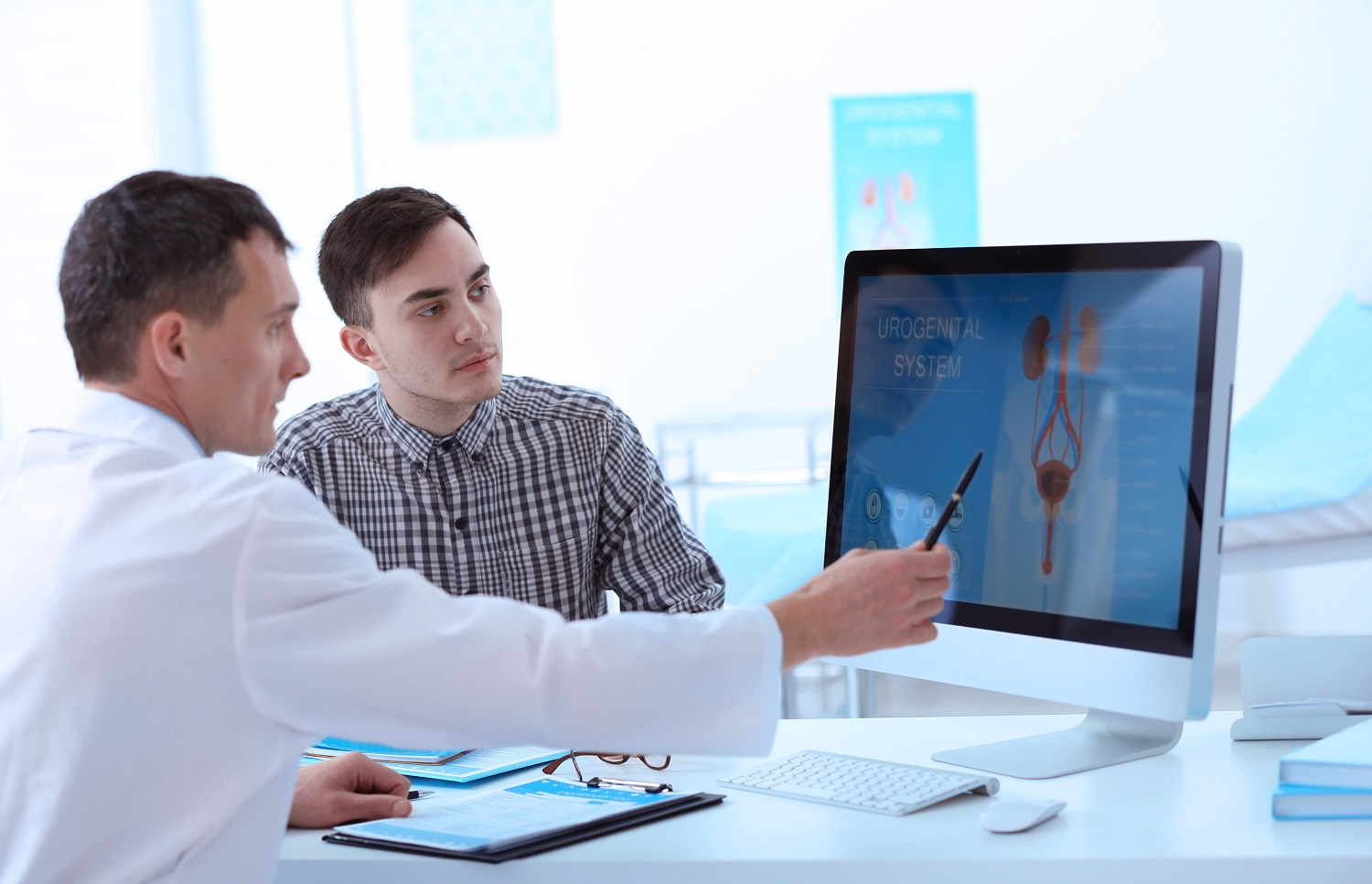 Medical concept. Doctor showing results of urology diagnostic on computer monitor